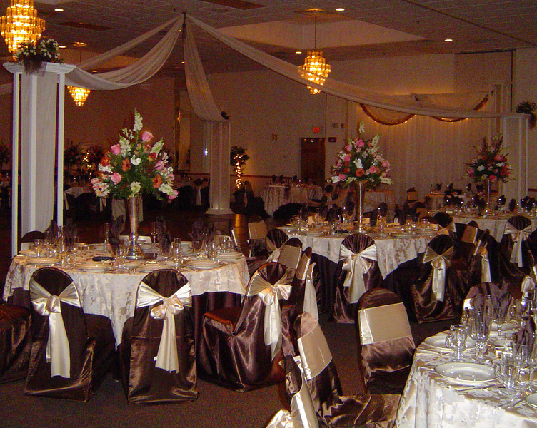 Chocolate and Champagne Wedding Dance Canopy featuring cream colored roses