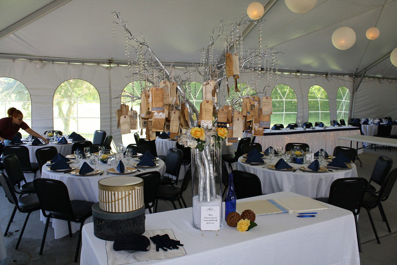 Tent wedding This crystal manzanita tree held the vintage luggage tag place