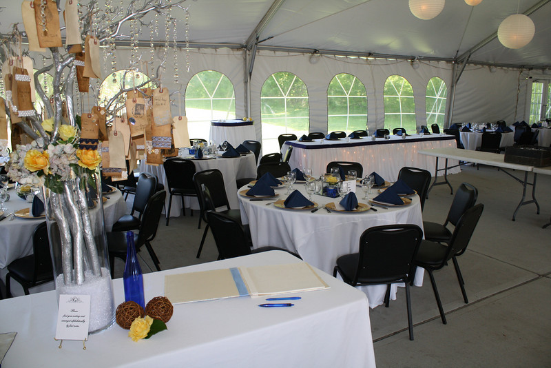 The head table and cake table are in the background