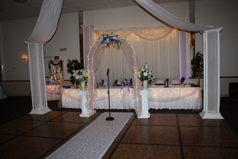 Wedding Arch Simple lighted wedding arch with tulle and silk flowers in