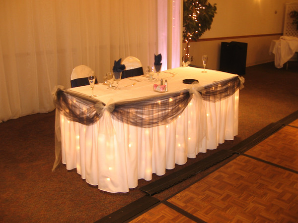 Navy Blue and White Wedding Lighted sweetheart table with navy blue tulle