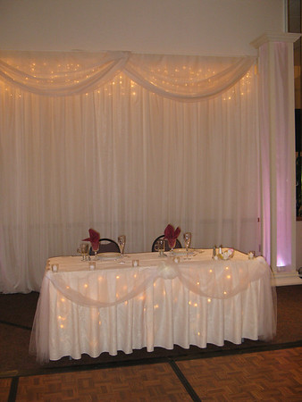 Sweetheart Table and Backdrop Lighted and decorated with ivory tulle