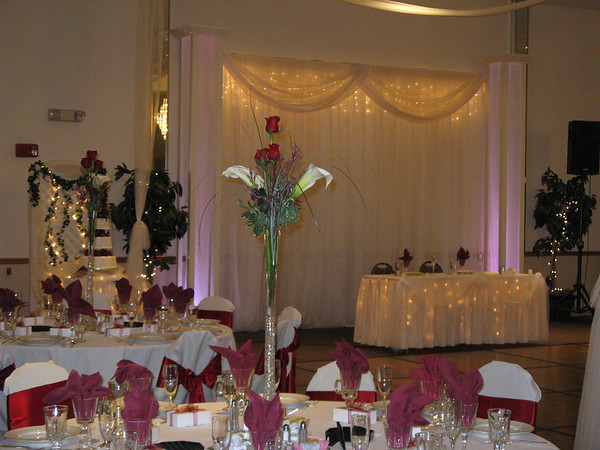 Red and Ivory Wedding Lighted and ivory tulle decorated sweetheart table
