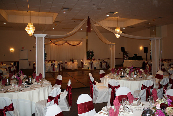 The centerpieces are hydrangeas in different shades of burgundy and pink by