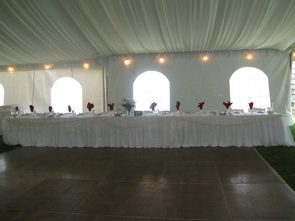 Red White Tent Wedding Decorated and Lighted Head Table