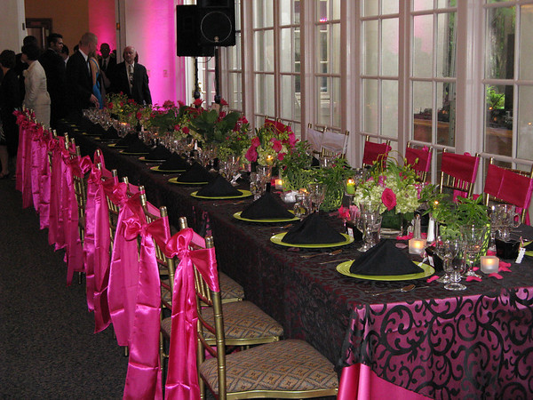 black and white wedding reception decor. Notice the white satin chair