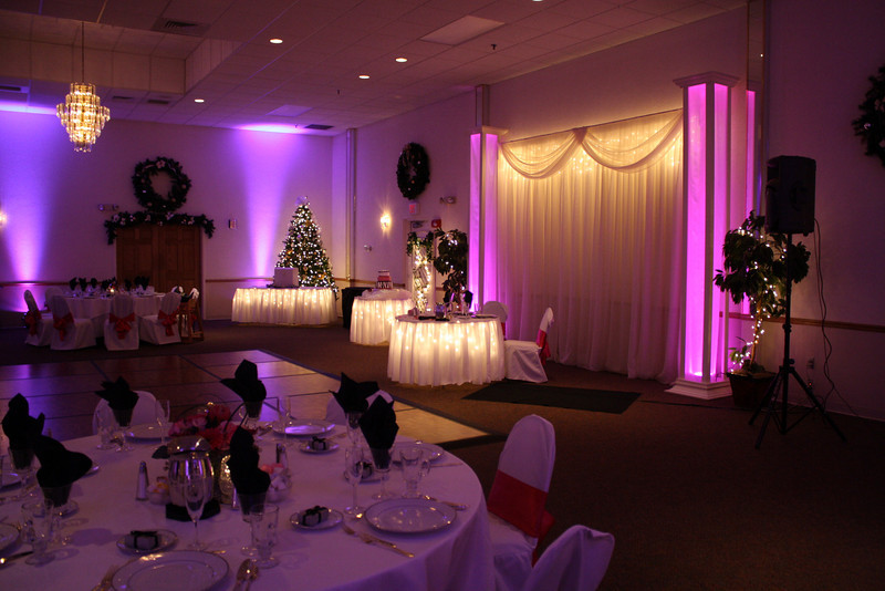 Pink Black and White Wedding Pink uplighting and under lighting on the